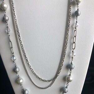 Three strand silver necklace with beads